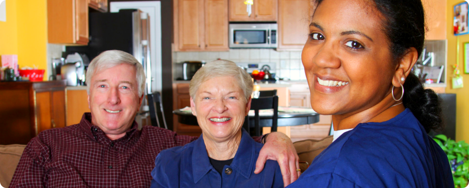 two elderly with their caregiver