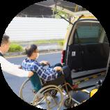 caregiver assisting elderly man in the car